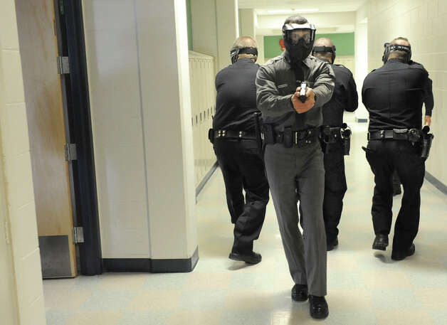 East Greenbush police officers run drills Wednesday in the hallways of Columbia High School in East Greenbush. The training was part of the police department's effort to prepare students for a shooting incident in places where there is a large gathering of people.  (Lori Van Buren / Times Union) Photo: Lori Van Buren