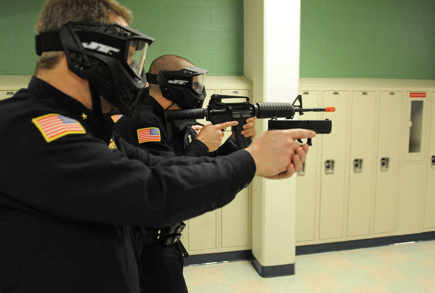 East Greenbush police officers run drills Wednesday in the hallways of Columbia High School in East