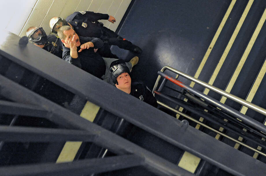Sgt. Jon Reickert of the Schodack Police Department, second from right, helps police officers run drills Wednesday  in the hallways, stairwells and classrooms as the East Greenbush Police Department hosts an ?active shooter? training class at Columbia High School. (Lori Van Buren / Times Union) Photo: Lori Van Buren