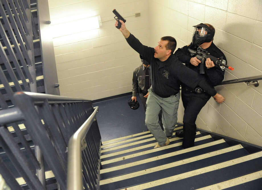 Sgt. Jon Reickert of the Schodack Police Department , left, helps police officers run drills Wednesday in the hallways, stairwells and classrooms as the East Greenbush Police Department host an ?active shooter? training class at Columbia High School.  (Lori Van Buren / Times Union) Photo: Lori Van Buren