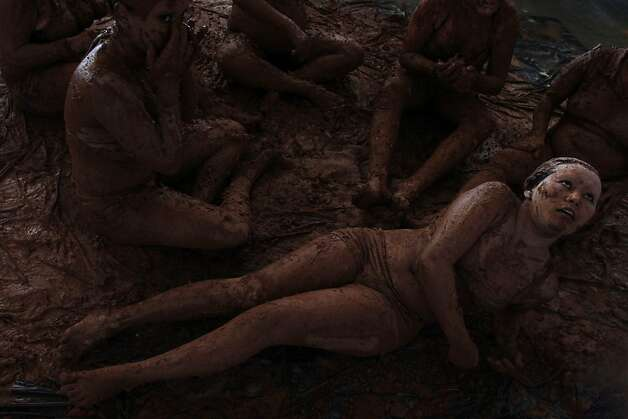 Women bathe in mud in a presentation for the inauguration of the National Meeting of Rural Women in Brasilia. The four-day event will address violence against Brazilian women and exploitation of them in rural areas. Photo: Eraldo Peres, Associated Press