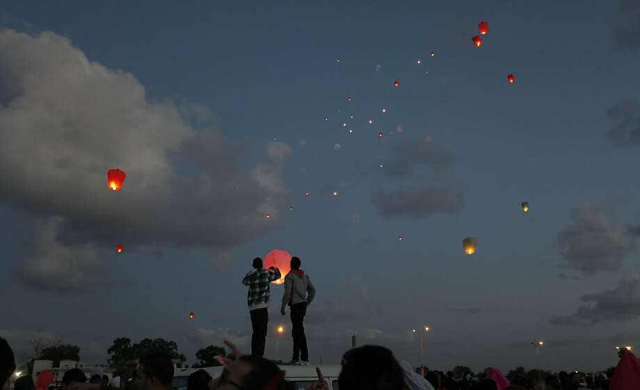 Two years Gadhafi-free:In Benghazi, Libyans release lanterns into the air during the second anniversary of the uprising that toppled Moammar Gadhafi. Photo: Mohammad Hannon, Associated Press