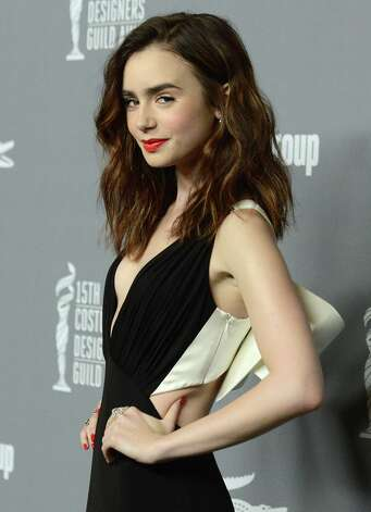 Lily Collins arrives at the 15th Annual Costume Designers Guild Awards at The Beverly Hilton Hotel on Tuesday, Feb. 19, 2013 in Beverly Hills. (Photo by Jordan Strauss/Invision/AP) Photo: Jordan Strauss, Associated Press / Invision