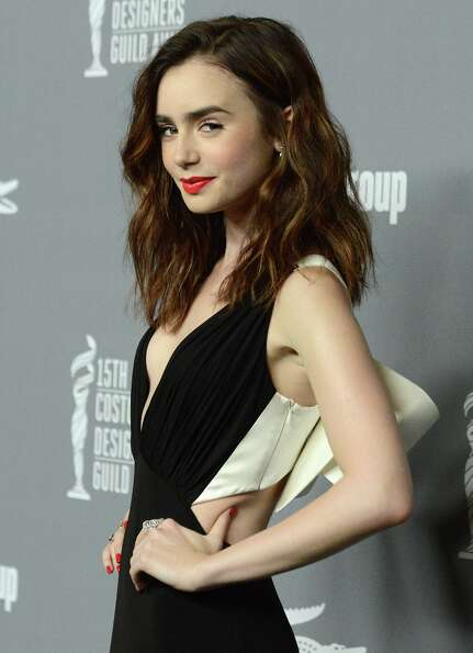 Lily Collins arrives at the 15th Annual Costume Designers Guild Awards at The Beverly Hilton Hotel o