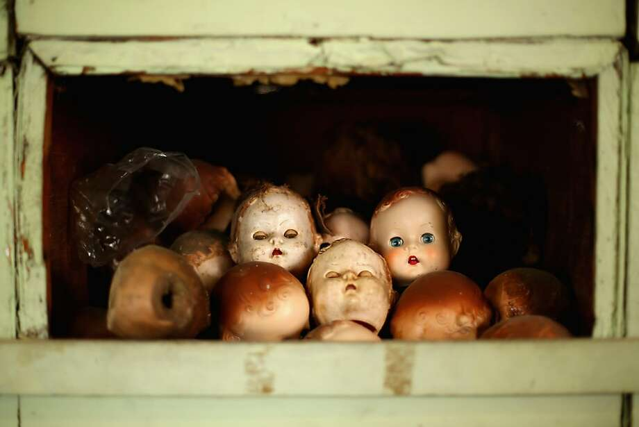 Pick one out from the 'expired patients' bin:Sydney's Original Doll Hospital in Bexley, Australia, is celebrating 100 years of treating all types of ailing dolls and teddy bears. It's the place to go if Dolly needs a new head. Photo: Mark Kolbe, Getty Images