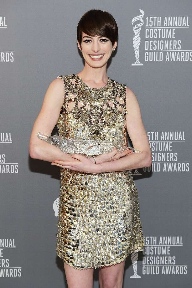 Actress Anne Hathaway poses with the Lacoste Spotlight Award during the 15th Annual Costume Designers Guild Awards with presenting sponsor Lacoste at The Beverly Hilton Hotel on February 19, 2013 in Beverly Hills, California. Photo: Michael Kovac, Getty Images For CDG / 2013 Getty Images