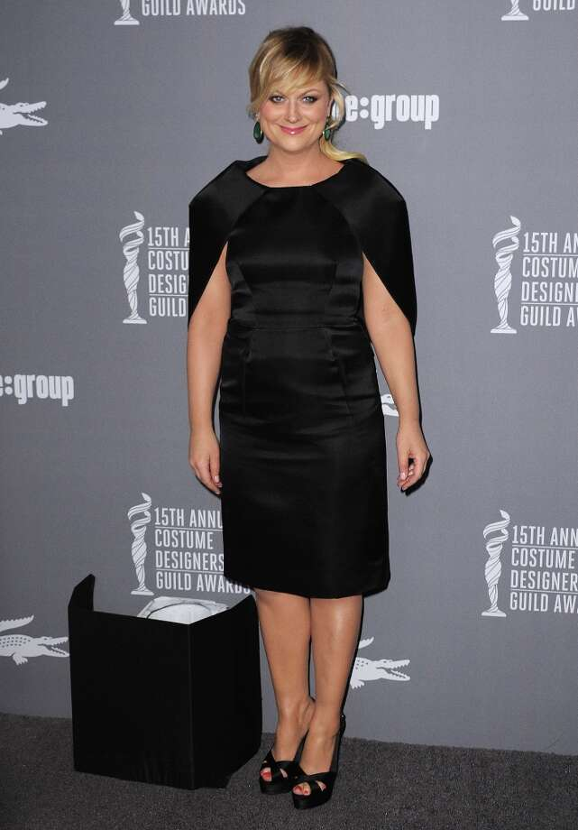 Amy Poehler arrives at the 15th Annual Costume Designers Guild Awards at The Beverly Hilton Hotel on Tuesday, Feb. 19, 2013 in Beverly Hills. (Photo by Jordan Strauss/Invision/AP) Photo: Jordan Strauss, Associated Press / Invision