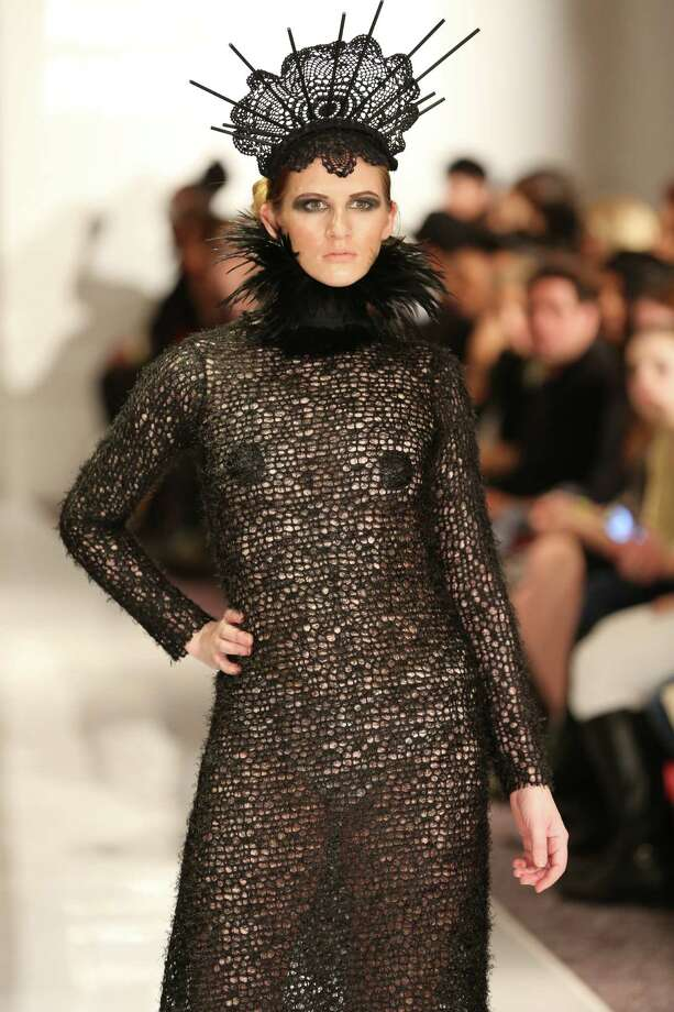 A model wears a soft but edgy design of a black knit long-sleeved dress that was accessorized with a feathered choker, and on top of the model's head, a mantilla-laced crown. The look is by San Antonio designer Samantha Plasencia, 26, an award-winning fashion grad of the University of the Incarnate Word. Plasencia was invited to participate in the Plitzs New York City Fashion Week event, an off shoot of Mercedes-Benz Fashion Week. Photo: Courtesy Photo By Brian Cunningh