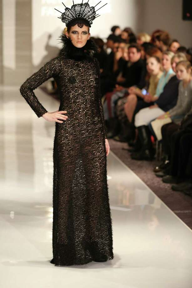 A model wears a soft but edgy design of a black knit long-sleeved dress that was accessorized with a feathered choker, and on top of the model's head, a mantilla-laced crown. The look is by San Antonio designer Samantha Plasencia, 26, an award-winning fashion grad of the University of the Incarnate Word. Plasencia was invited to participate in the Plitzs New York City Fashion Week event, an off shoot of Mercedes-Benz Fashion Week. Photo: Courtesy Photy By Brian Cunningh