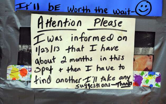 A sign posted on CarolynâÄôs Weenie Wagon Wednesday, Feb. 20, 2013 at its currect location between the site of the former Housatonic Wire Co. factory building on River Street and former Seymour Lumber Company on Bank Street in Seymour, Conn. asks customers for advice on a new home.  The Weenie Wagon will have to relocate because Seymour Lumber Company plans to sell the site. Photo: Autumn Driscoll / Connecticut Post