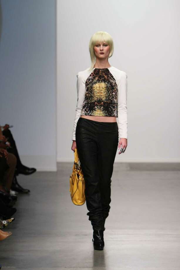 A model wears a top constructed of a black and gold print python print by San Antonio designer Mandi Gallegos who presented a fall 2013 collection at Nolcha Fashion Week in New York, an off-shoot of Manhattan's Mercedes-Benz Fashion Week.