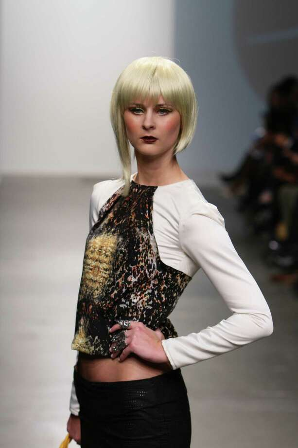 A model wears a top constructed of a black and gold print python print by San Antonio designer Mandi Gallegos who presented a fall 2013 collection at Nolcha Fashion Week in New York, an off-shoot of Manhattan's Mercedes-Benz Fashion Week. Photo: Nolcha Fashion Week