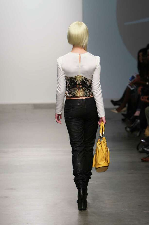 A model wears a top constructed of a black and gold print python print over black ankle-ruched trousers by San Antonio designer Mandi Gallegos who presented a fall 2013 collection at Nolcha Fashion Week in New York, an off-shoot of Manhattan's Mercedes-Benz Fashion Week. Photo: Nolcha Fashion Week