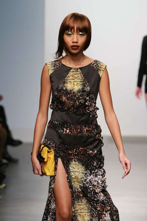 A sleeveless long dress constructed of a black and gold python print by San Antonio designer Mandi Gallegos who presented a fall 2013 collection at Nolcha Fashion Week in New York, an off-shoot of Manhattan's Mercedes-Benz Fashion Week. Photo: Nolcha Fashion Week