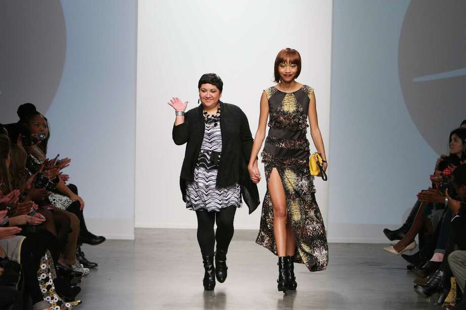 Mandi Gallegos takes a bow at the end of her New York fashion show with model Dominique Babineaux, also of San Antonio. Photo: Nolcha Fashion Week
