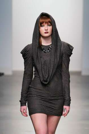 A model wears a short and fitted dress with cowl detailing by San Antonio designer Mandi Gallegos who presented a fall 2013 collection at Nolcha Fashion Week in New York, an off-shoot of Manhattan's Mercedes-Benz Fashion Week. Photo: Nolcha Fashion Week