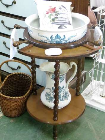 Sweet washstand, $115, and pillow, $16, can be found at Artiqueology. Photo: Jennifer Rodriguez