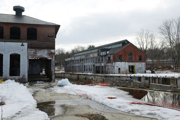 The former Gilbert & Bennett factory property in Georgetown, Conn., shown here Wednesday, Feb. 20, 2013, will soon undergo a transformation for new residential, commerical and retail use.  Property manager Chris Lynch and his team have already completed smaller projects surrounding the factory, including a new road by the property entrance, sidewalks and traffic signal. Photo: Tyler Sizemore / The News-Times