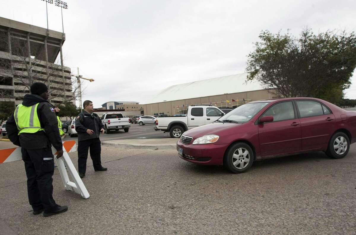 Texas A&M security personnel who wished not to be identified stop a vehicle at the entrance to Kyle Field after a bomb threat Wednesday Feb. 20, 2013 in College Station, Texas. Texas A&M University is investigating a bomb threat at Kyle Field that prompted the school to issue a