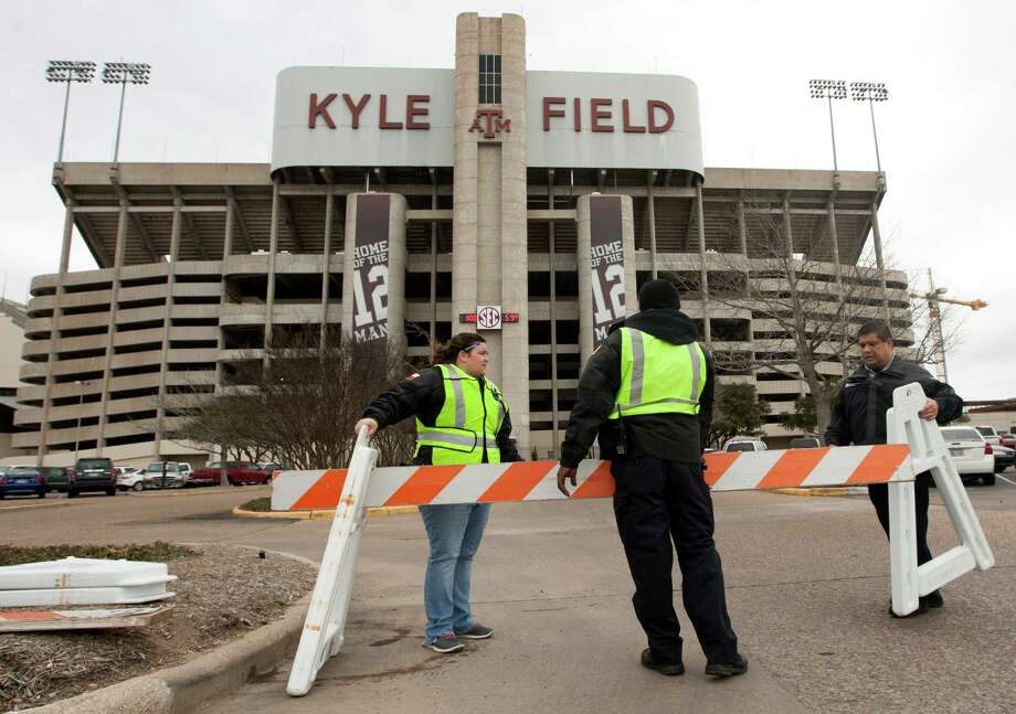 "Texas A&M security personnel who wished not to be identified barricade the entrance to Kyle Field after a bomb threat Wednesday Feb. 20, 2013 in College Station, Texas. Texas A&M University is investigating a bomb threat at Kyle Field that prompted the school to issue a ""code maroon"" safety advisory and close the stadium and nearby buildings. (AP Photo/ Patric Schneider) Photo: Patric Schneider, Associated Press / FR170473 AP"