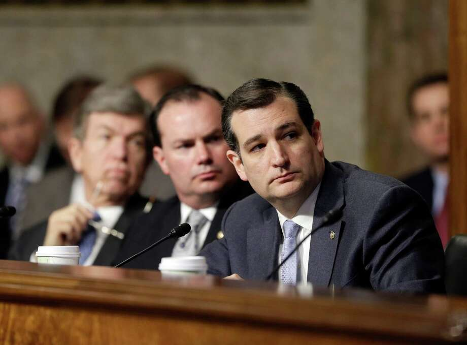 Sen. Ted Cruz (right) watches a video he provided with GOP members of the Senate Armed Services Committee during his questioning of Chuck Hagel. Cruz is on a path that leads to the fringes of his party. Photo: J. Scott Applewhite, Associated Press / AP