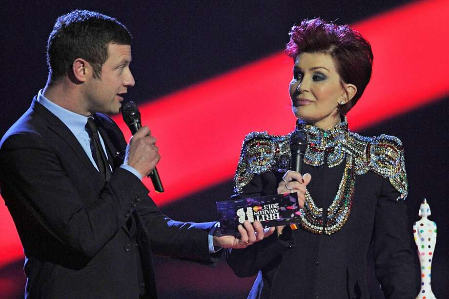 LONDON, ENGLAND - FEBRUARY 20:  (L-R) Dermot O'Leary and Sharon Osbourne present the award for International Female Solo Artist on stage during the Brit Awards 2013 at the 02 Arena on February 20, 2013 in London, England.  (Photo by Matt Kent/Getty Images) Photo: Matt Kent, Getty Images