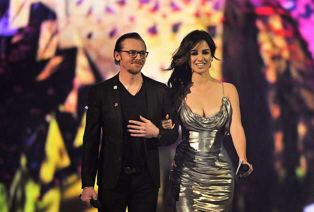 LONDON, ENGLAND - FEBRUARY 20:  Simon Pegg and Berenice Marlohe arrive to present British Group on stage during the Brit Awards 2013 at the 02 Arena on February 20, 2013 in London, England.  (Photo by Matt Kent/Getty Images) Photo: Matt Kent, Getty Images