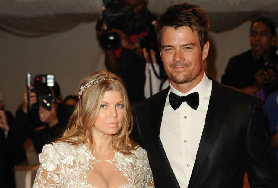 FILE - This is a Monday May 2, 2011 file photo of singer Fergie and her husband, actor Josh Duhamel, arrive at the Metropolitan Museum of Art Costume Institute gala, Monday, May 2, 2011 in New York. Actor Josh Duhamel and his wife, Black Eyed Peas singer Fergie, have already started doing their homework as they prepare to welcome their first child they said Wednesday Feb. 20, 2013.  (AP Photos/Peter Kramer, File) Photo: Peter Kramer