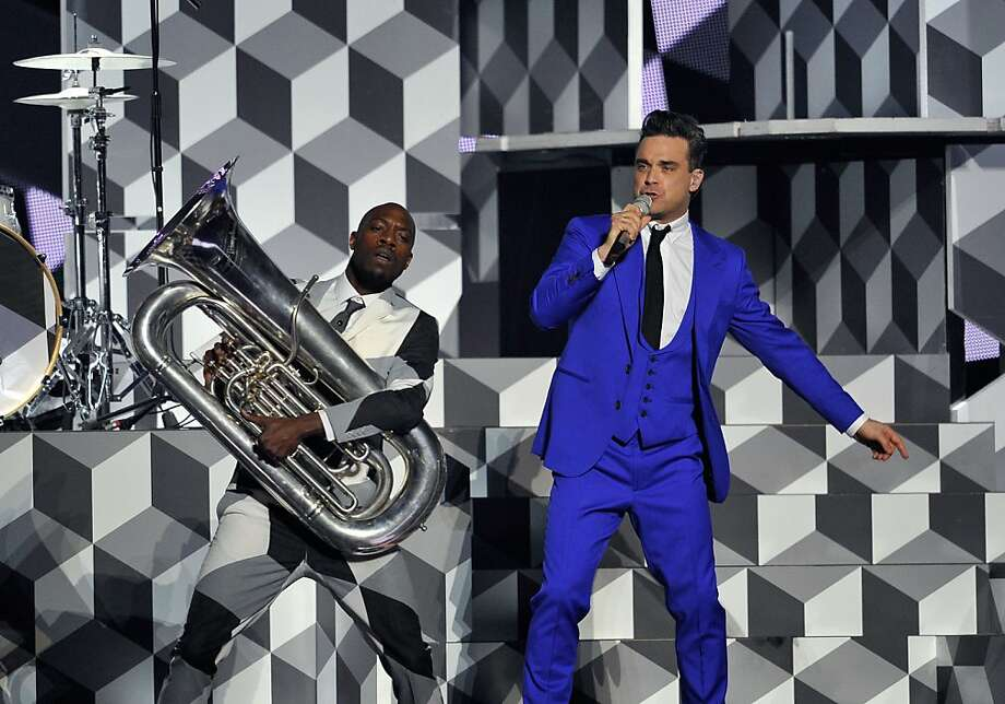 LONDON, ENGLAND - FEBRUARY 20:  Robbie Williams performs on stage during the Brit Awards 2013 at the 02 Arena on February 20, 2013 in London, England.  (Photo by Matt Kent/Getty Images) Photo: Matt Kent, Getty Images