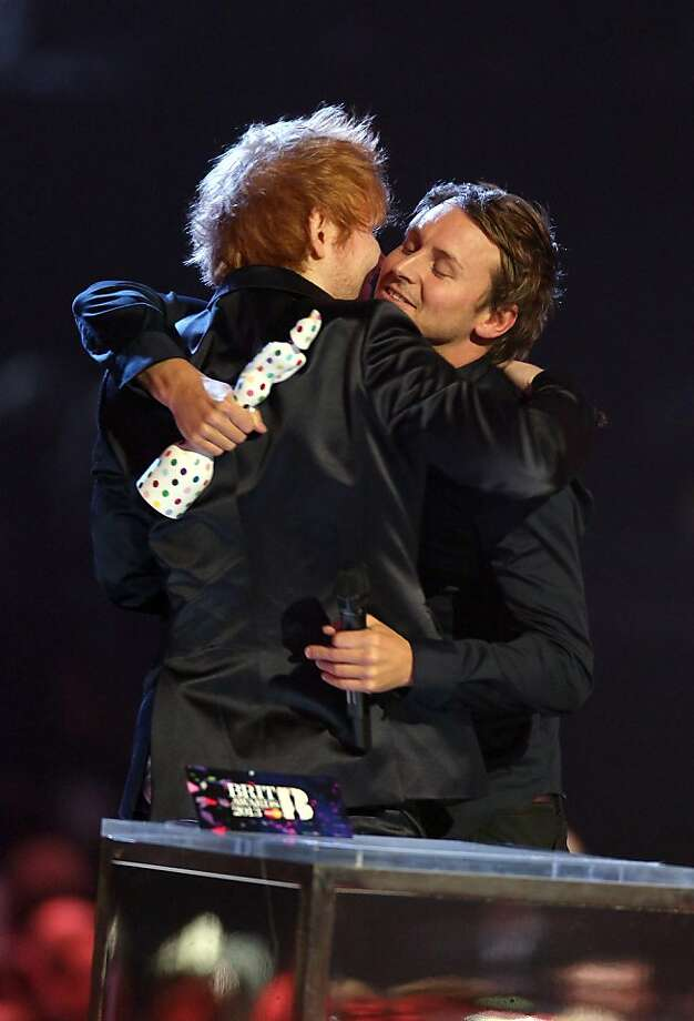 Ed Sheeran, left, embraces Ben Howard, winner of the Best British Male award during the BRIT Awards 2013 at the o2 Arena in London on Wednesday, Feb. 20, 2013. Ben Howard won the award for British Breakthrough and British Male. (Photo by Joel Ryan/Invision/AP) Photo: Joel Ryan, Associated Press