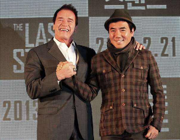 "Actor Arnold Schwarzenegger, left, poses with South Korean director Kim Jee-woon before a press conference to promote their latest film ""The Last Stand"" in Seoul, South Korea, Wednesday, Feb. 20, 2013. The movie will open on Thursday, Feb. 21, in South Korea.  (AP Photo Ahn Young-joon) Photo: Ahn Young-joon"