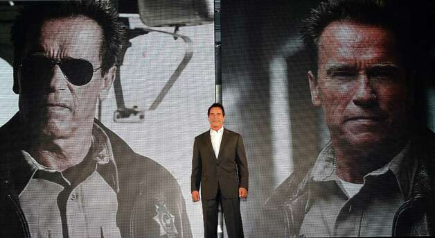 "Actor Arnold Schwarzenegger poses during a press conference to promote his latest film ""The Last Stand"" in Seoul, South Korea, Wednesday, Feb. 20, 2013. The movie will open on Thursday, Feb. 21, in South Korea.  (AP Photo Ahn Young-joon) Photo: Ahn Young-joon"