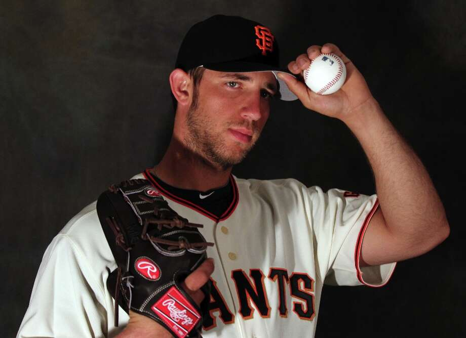 San Francisco Giants pitcher Madison Bumgarner poses for photographers during photo day at spring training Wednesday, Feb. 20, 2013, in Scottsdale, Ariz. Photo: Lance Iversen, The Chronicle / ONLINE_YES