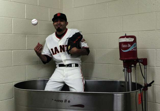 San Francisco Giants pitcher Sergio Romo sits in a whirlpool hot tub for photographers during photo day at spring training Wednesday, Feb. 20, 2013, in Scottsdale, Ariz. Photo: Lance Iversen, The Chronicle / ONLINE_YES