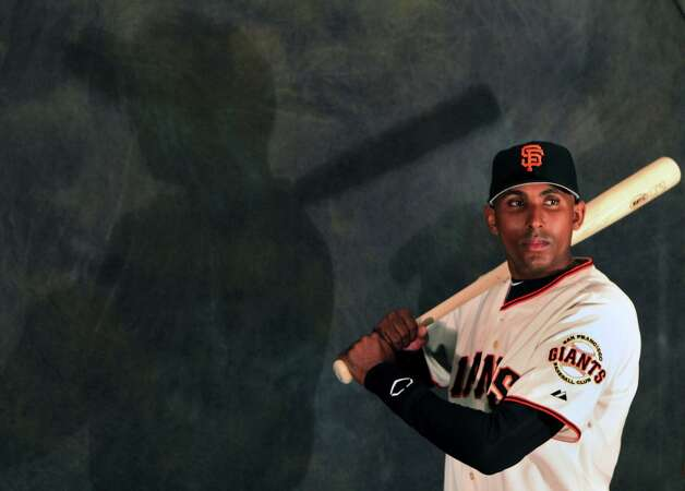 San Francisco Giants infielder' Joaquin Arias poses for photos during photo day at spring training Wednesday, Feb. 20, 2013, in Scottsdale, Ariz. Photo: Lance Iversen, The Chronicle / ONLINE_YES