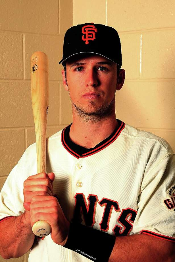 Catcher Buster Posey #28 poses for a portrait during San Francisco Giants Photo Day on February 20, 2013 in Scottsdale, Arizona. Photo: Jamie Squire, Getty Images / 2013 Getty Images