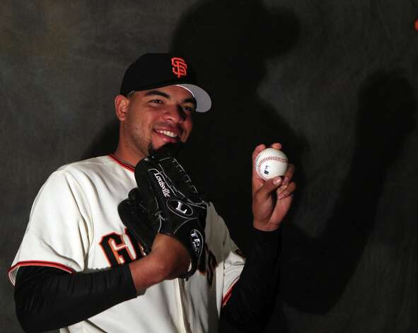 San Francisco Giants pitcher Edwin Escobar poses for photos during photo day at spring training Wednesday, Feb. 20, 2013, in Scottsdale, Ariz. Photo: Lance Iversen, The Chronicle / ONLINE_YES