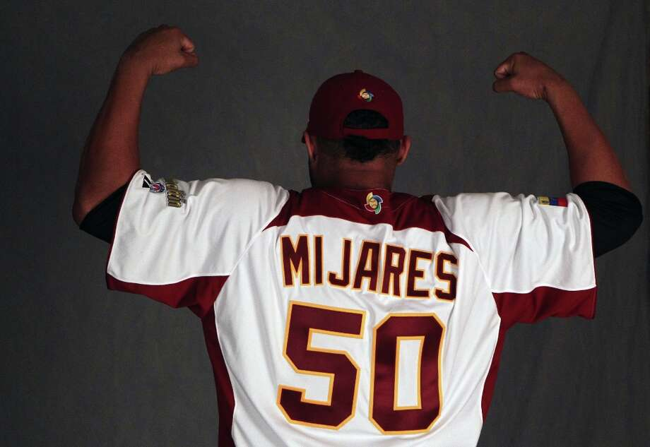 San Francisco Giants pitcher Jose Mijares poses in his World Baseball Classic jersey that he will wear when he represents Venezuela. The Giants took part in photo day at spring training Wednesday, Feb. 20, 2013, in Scottsdale, Ariz. Photo: Lance Iversen, The Chronicle / ONLINE_YES