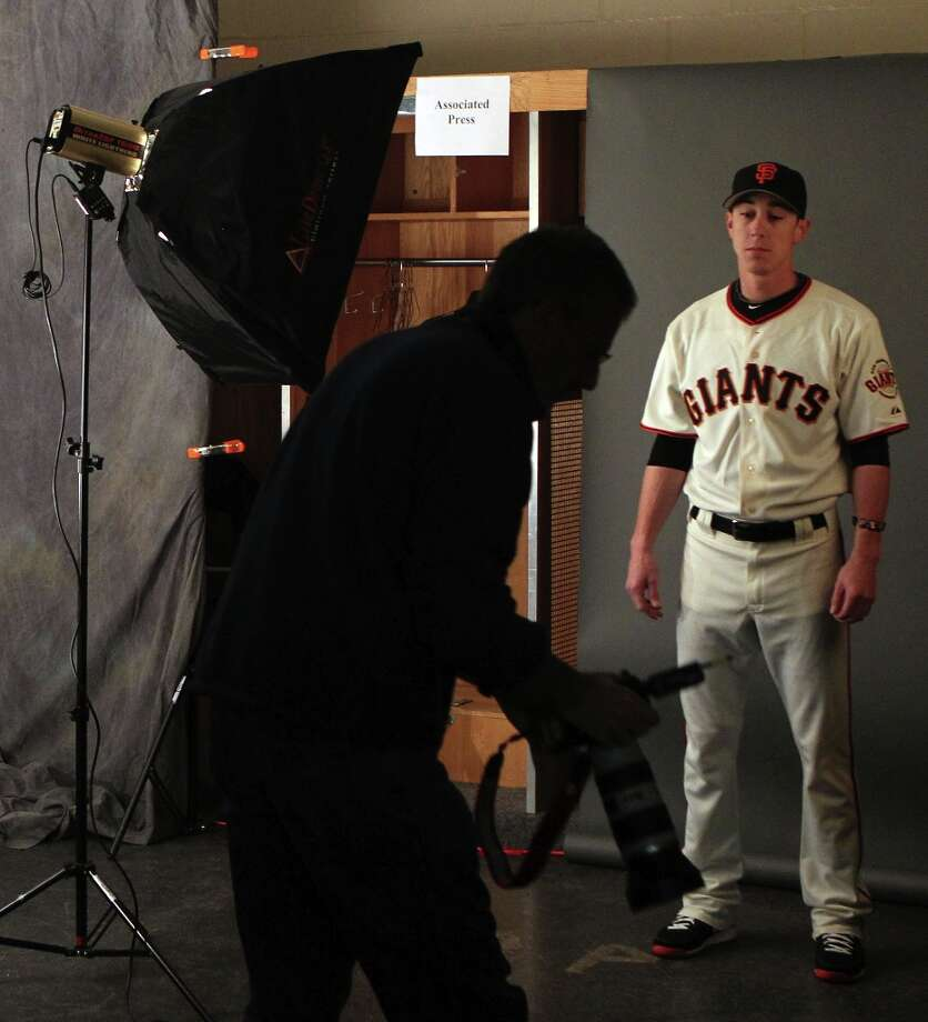 Associated Press staff photographer Morry Gash photographs San Francisco Giants pitcher Tim Lincecum during photo day at spring training Wednesday, Feb. 20, 2013, in Scottsdale, Ariz. Photo: Lance Iversen, The Chronicle / ONLINE_YES