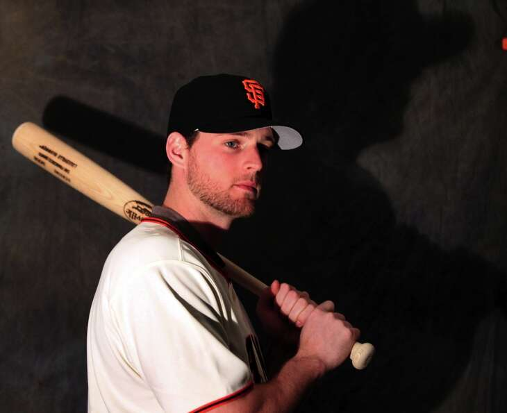 San Francisco Giants infielder' Conor Gillaspie poses for photos during photo day at spring training