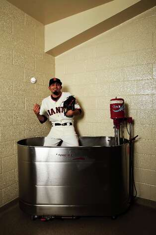 Pitcher Sergio Romo poses for a portrait during San Francisco Giants Photo Day on February 20, 2013 in Scottsdale, Arizona. Photo: Jamie Squire, Getty Images / 2013 Getty Images