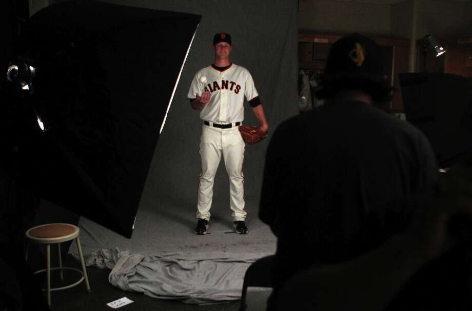 Photographers photograph San Francisco Giants pitcher Matt Cain during photo day at spring training Wednesday, Feb. 20, 2013, in Scottsdale, Ariz. Photo: Lance Iversen, The Chronicle / ONLINE_YES