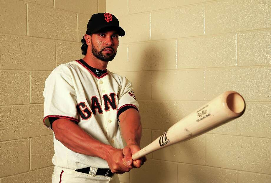 Angel Pagan poses for a portrait during San Francisco Giants Photo Day on February 20, 2013 in Scottsdale, Arizona. Photo: Jamie Squire, Getty Images / 2013 Getty Images