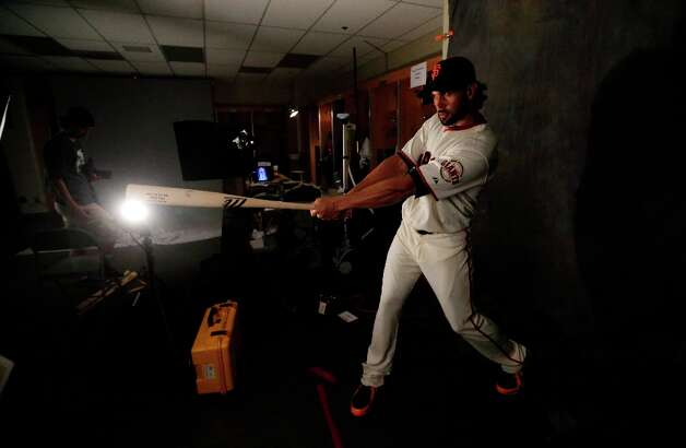 Angel Pagan poses for a picture during baseball spring training photo day Wednesday, Feb. 20, 2013 in Scottsdale, Ariz. Photo: Morry Gash, Associated Press / AP