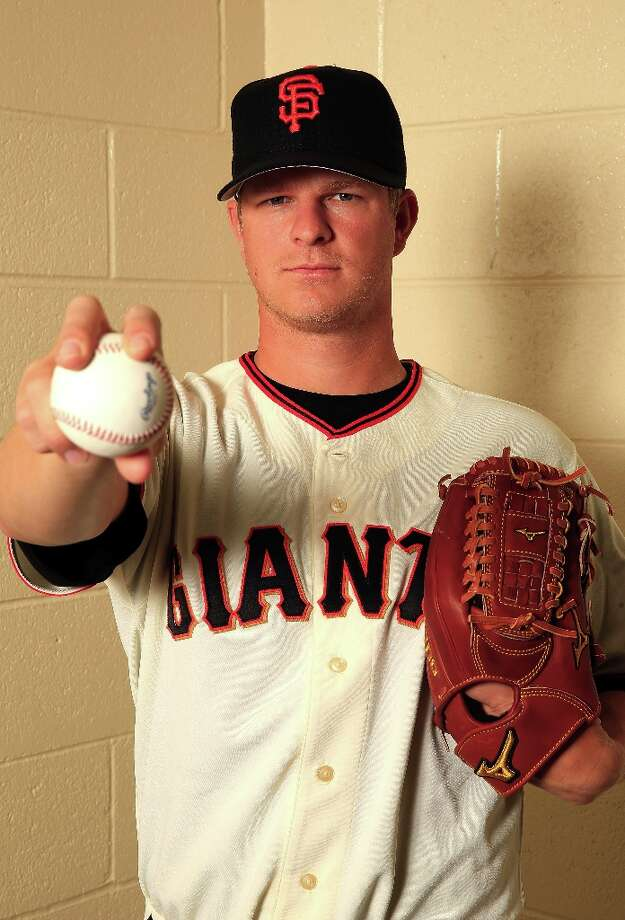 Pitcher Matt Cain #18 poses for a portrait during San Francisco Giants Photo Day on February 20, 2013 in Scottsdale, Arizona. Photo: Jamie Squire, Getty Images / 2013 Getty Images
