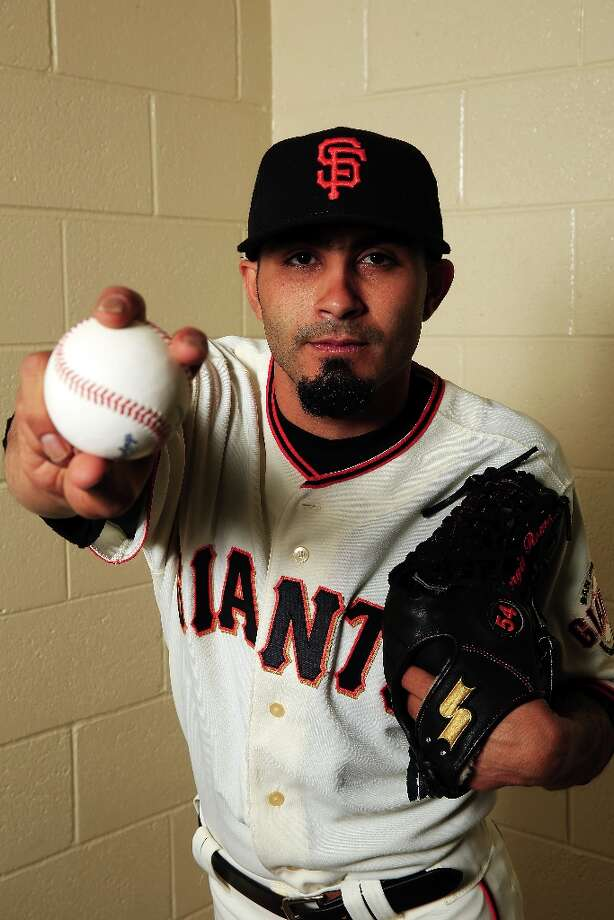 Sergio Romo poses for a portrait during San Francisco Giants Photo Day on February 20, 2013 in Scottsdale, Arizona. Photo: Jamie Squire, Getty Images / 2013 Getty Images