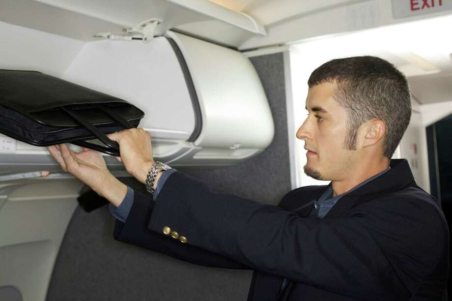 6. Bin hogging. These days, everyone's rolling a suitcase aboard, and we all know there's not enough room. So keep the briefcase under the seat in front of you, OK pal? Photo: Thinkstock, Getty Images/Comstock Images / Comstock Images
