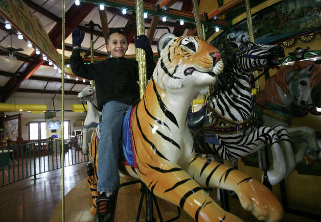 James El-Hage, 7 of West Haven, rides his favorite carousel animal, the tiger, during a visit to the Beardsley Zoo in Bridgeport on Wednesday, February 20, 2013. Photo: Brian A. Pounds / Connecticut Post
