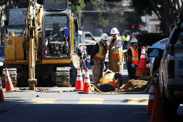 PG&E crews work at the site of a gas leak at the intersection of 24th and Bryant streets on Wednesday, February 20, 2013 in San Francisco, Calif. Photo: Lea Suzuki, The Chronicle