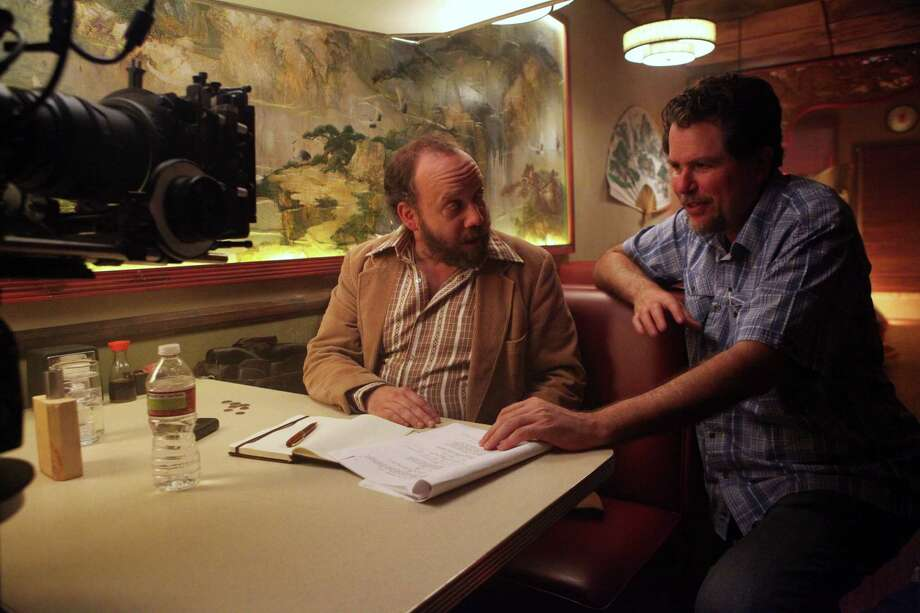 "Paul Giamatti, left, and director Don Coscarelli discuss a scene on the set of ""John Dies at the End."" Giamatti helped Coscarelli get the film made. Photo: Magnet Releasing"
